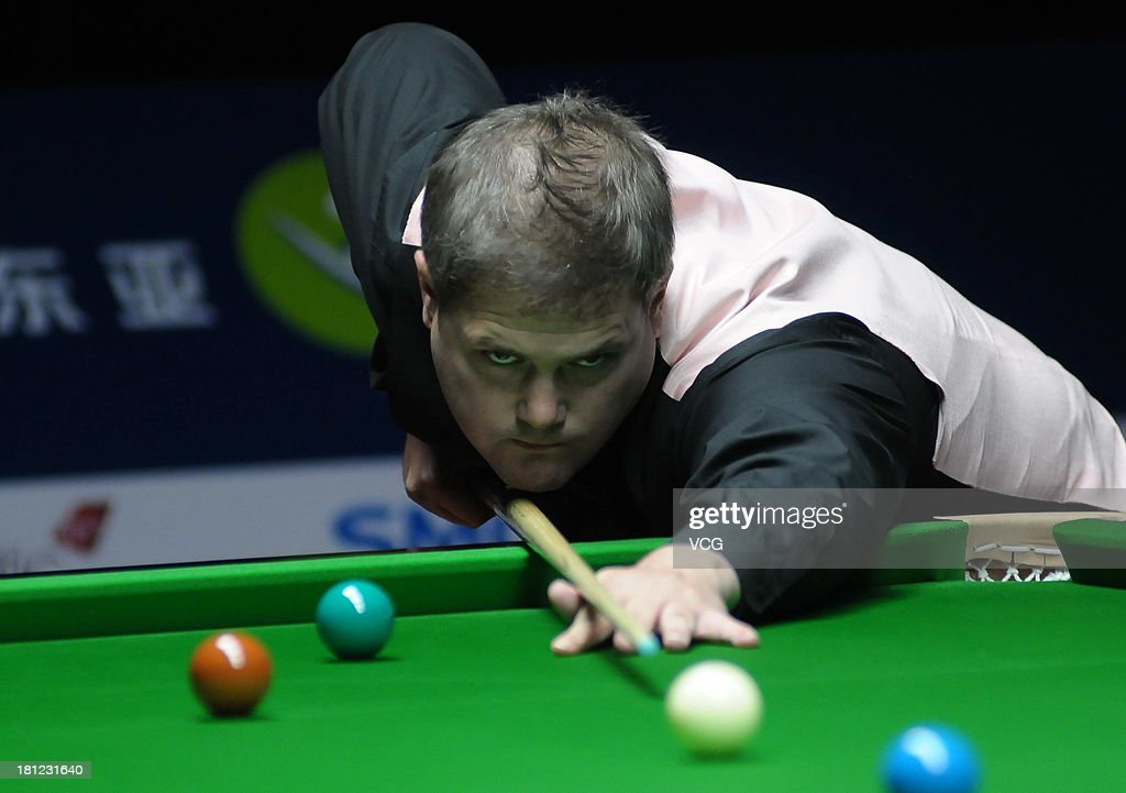 Robert Milkins of England plays a shot in the match against Mark Selby of England on day four of the 2013 World Snooker Shanghai Master at Shanghai Grand Stage on September 19, 2013 in Shanghai, China.