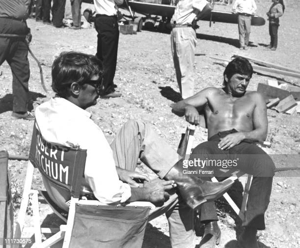 Robert Mitchum and Charles Bronson during a break from filming the movie 'Villa Rides' near Madrid directed by Buzz Kulik Madrid Spain