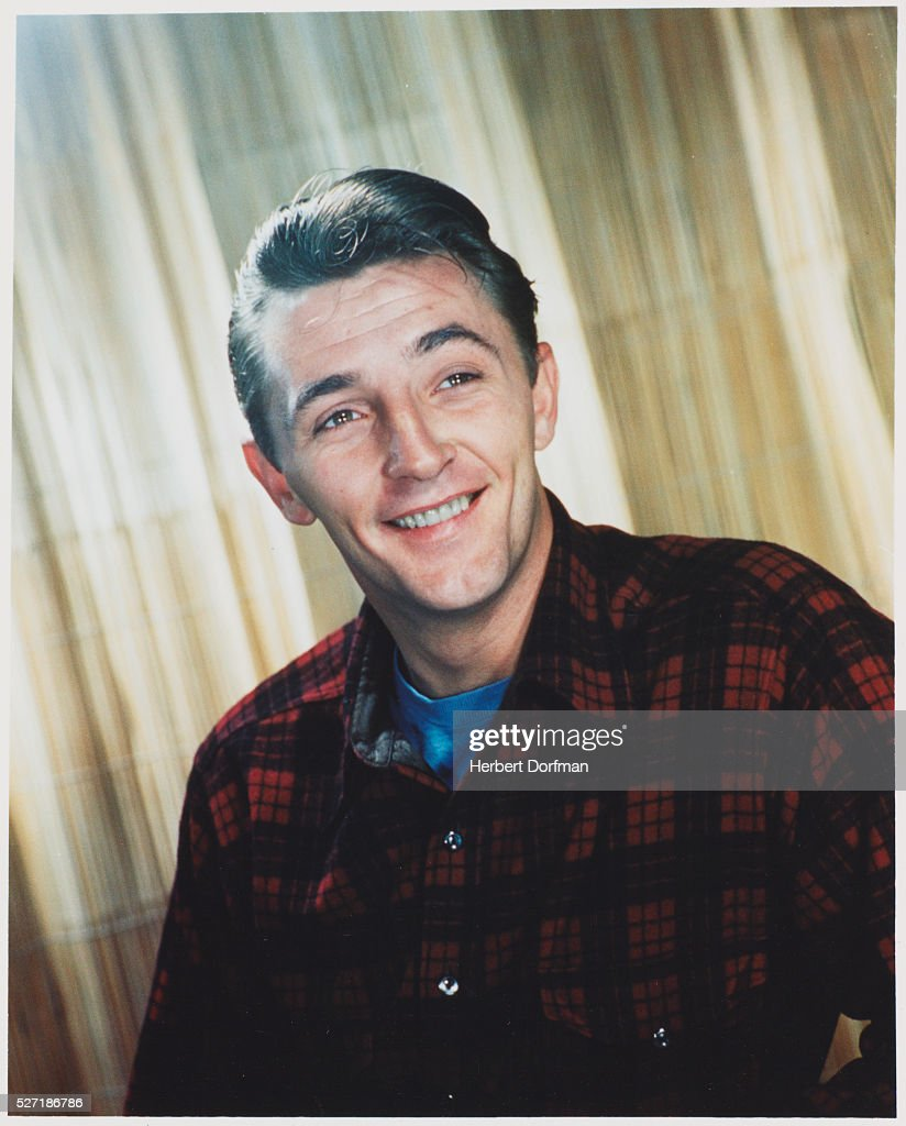 <a gi-track='captionPersonalityLinkClicked' href=/galleries/search?phrase=Robert+Mitchum&family=editorial&specificpeople=206827 ng-click='$event.stopPropagation()'>Robert Mitchum</a> Wearing a Plaid Shirt