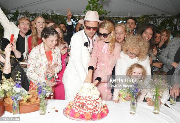 Robert Montgomery and Greta Bellamacina cut the cake surrounded by guests at their wedding on July 8 2017 in Exeter England