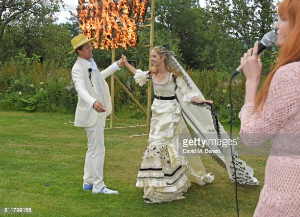 Robert Montgomery and Greta Bellamacina dance as Florence Welch performs at their wedding on July 8 2017 in Exeter England