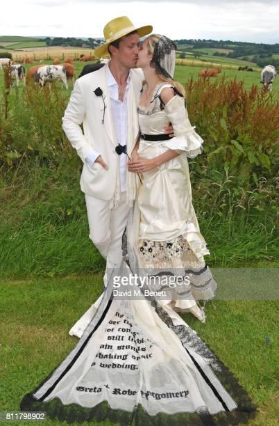 Robert Montgomery and Greta Bellamacina pose at their wedding on July 8 2017 in Exeter England