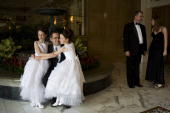 Robert Moore poses for a photograph with his 9yearold twin daughters Lauren and Elizabeth on May 16 2008 in Colorado Springs Colorado The annual...