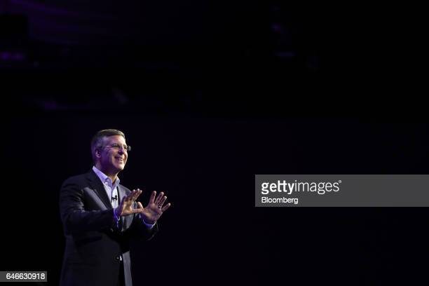 Robert Moritz chairman of PricewaterhouseCoopers International Ltd gestures while speaking on the third day of Mobile World Congress in Barcelona...
