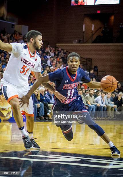 Robert Morris Dachon Burke drives to the basket during an NCAA basketball game between the Virginia Cavaliers and the Robert Morris Colonials on...