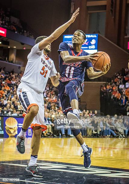 Robert Morris Dachon Burke makes a move to shoot during an NCAA basketball game between the Virginia Cavaliers and the Robert Morris Colonials on...