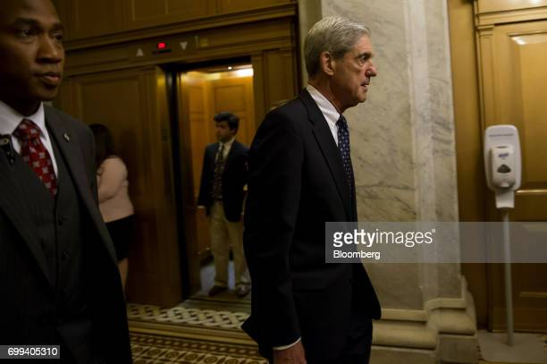 Robert Mueller former director of the Federal Bureau of Investigation and special counsel for the US Department of Justice leaves a meeting with...