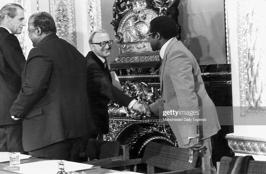 Robert Mugabe shaking the hand of Lord Carrington, Foreign Secretary. Rhodesia, a former British colony, became officially independent in 1979 and was re-named Zimbabwe. Peter Carrington chaired the conference which resulted in the Lancaster House Agreement . The agreement, which ended white rule in Rhodesia under Ian Smith, was signed on 21 December 1979, by the Patriotic Front (PF), consisting of ZANU (Zimbabwe African National Union) led by Mugabe, ZAPU (Zimbabwe African Peoples Union) led by Joshua Nkomo (second left), and the Zimbabwe Rhodesia government, represented by Bishop Abel Muzorewa and Ian Smith.