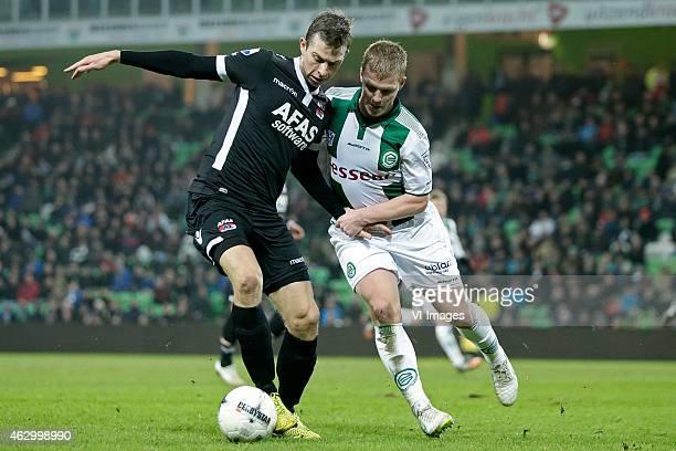 Robert Muhren of AZ Simmon Tibbling of FC Groningen during the Dutch Eredivisie match between FC Groningen and AZ Alkmaar at Euroborg on February 8...