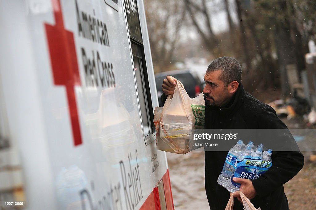 Robert Munoz collects supplies from a mobile Red Cross unit on November 7, 2012 in the Staten Island borough of New York City. He and fellow residents of the seaside Midland Beach area of Staten Island prepared for a Nor'Easter storm that could potentially re-flood areas devastated by Superstorm Sandy.