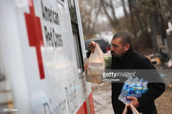 Robert Munoz collects supplies from a mobile Red Cross unit on November 7 2012 in the Staten Island borough of New York City He and fellow residents...