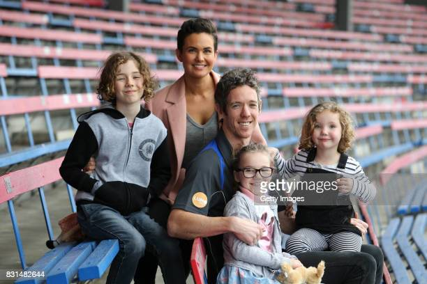 Robert Murphy and his wife Justine Murphy pose with their children Jarvis Frankie and Delilah following his AFL retirement announcement during a...