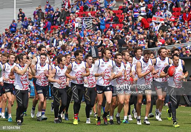 Robert Murphy and the Bulldogs thanks their supporters in the crowd during the Western Bulldogs AFL media opportunity and training session at Whitten...