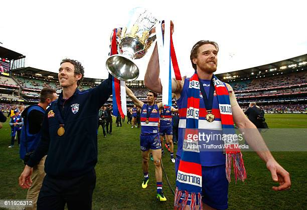 Robert Murphy of the Bulldogs and Jordan Roughead of the Bulldogs carry the premiership cup off the field during the 2016 Toyota AFL Grand Final...
