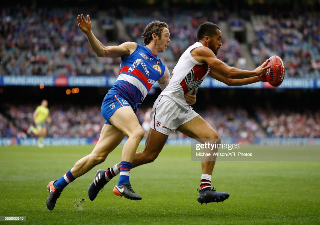 Robert Murphy of the Bulldogs and Shane Savage of the Saints compete for the ball during the 2017 AFL round 10 match between the Western Bulldogs and the St Kilda Saints at Etihad Stadium on May 27, 2017 in Melbourne, Australia.