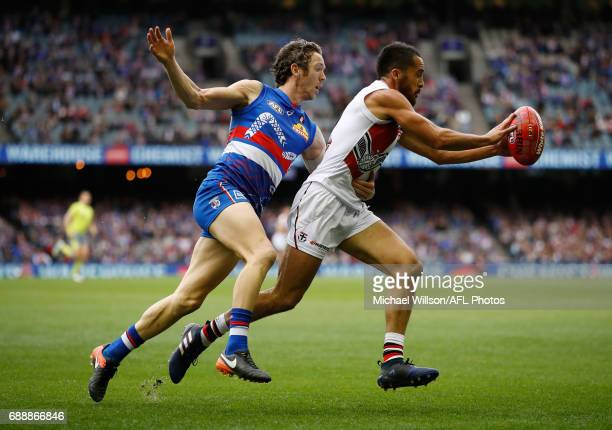 Robert Murphy of the Bulldogs and Shane Savage of the Saints compete for the ball during the 2017 AFL round 10 match between the Western Bulldogs and...