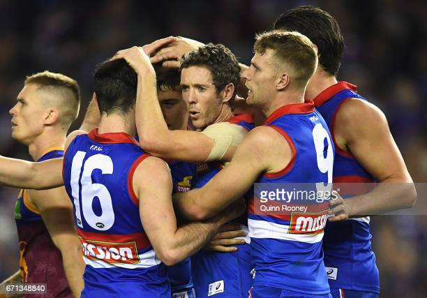 Robert Murphy of the Bulldogs celebrates a goal with team mates during the round five AFL match between the Western Bulldogs and the Brisbane Lions...