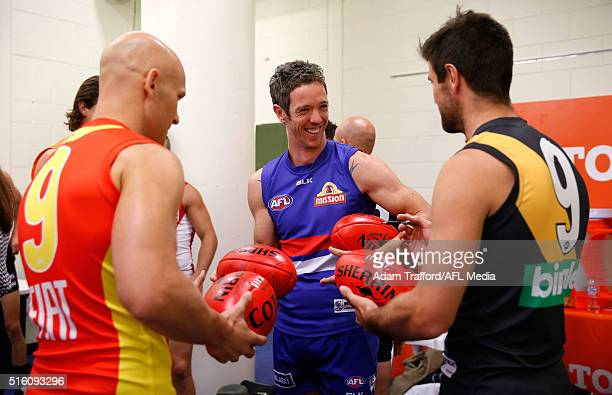 Robert Murphy of the Bulldogs chats with Gary Ablett of the Suns and Trent Cotchin of the Tigers during the 2016 AFL Captains Day at Etihad Stadium...