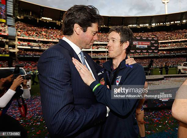 Robert Murphy of the Bulldogs is congratulated by Gillon McLachlan Chief Executive Officer of the AFL during the 2016 Toyota AFL Grand Final match...