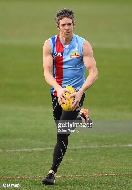 Robert Murphy of the Bulldogs kicks during a Western Bulldogs AFL training session at Whitten Oval on June 27 2017 in Melbourne Australia