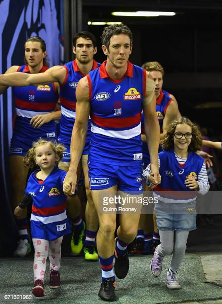 Robert Murphy of the Bulldogs leads his team out for his 300th game during the round five AFL match between the Western Bulldogs and the Brisbane...