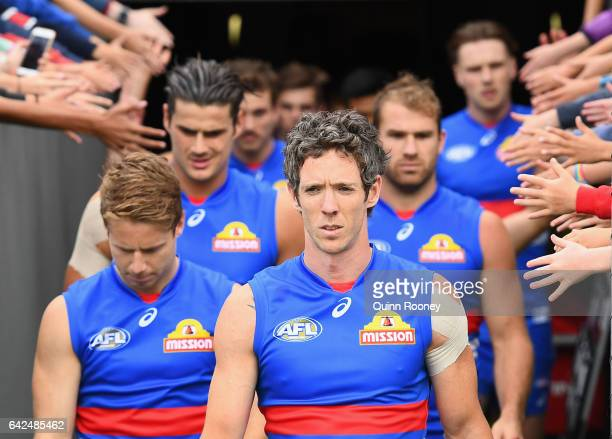 Robert Murphy of the Bulldogs leads his team out onto the field during the 2017 JLT Community Series match between the Western Bulldogs and the...