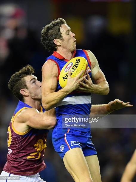Robert Murphy of the Bulldogs marks infront of Daniel McStay of the Lions during the round five AFL match between the Western Bulldogs and the...