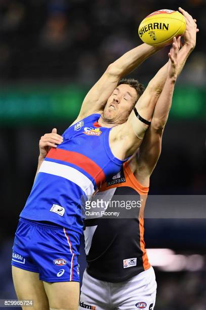 Robert Murphy of the Bulldogs marks infront of Lachie Whitfield of the Giants during the round 21 AFL match between the Western Bulldogs and the...