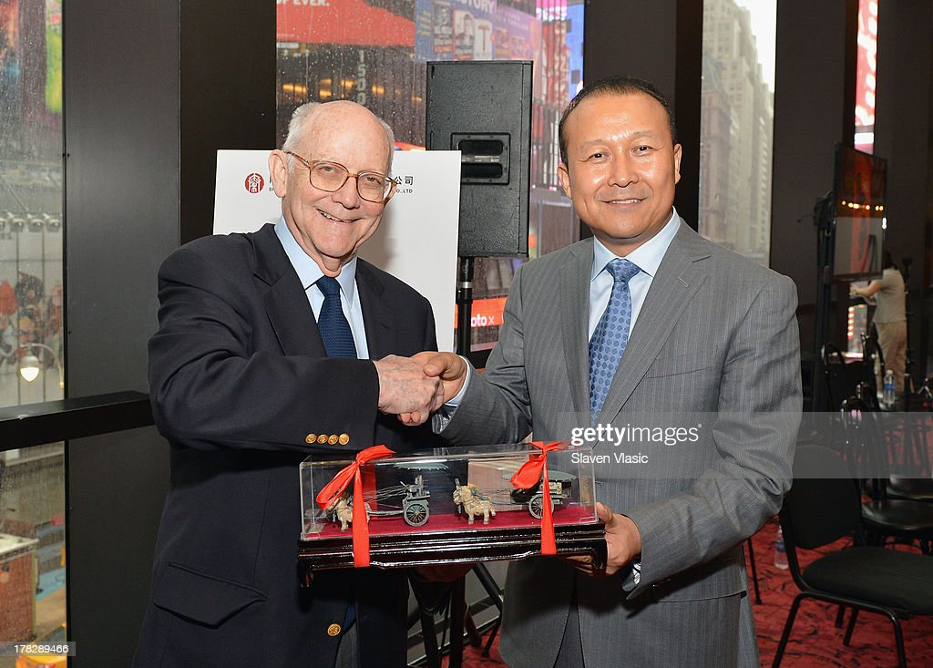 Robert Nederlander, Sr. (L), Chairman, Nederlander Worldwide Entertainment and Wang Yong, President, Qinhuang Grand Theater Performing Art Co, Ltd attend the announcement of a new spectacular entertainment and travel destination in China located in Xi'An on site of the legendary Terra Cotta Warriors & Horses, at Minskoff Theatre on August 28, 2013 in New York City.
