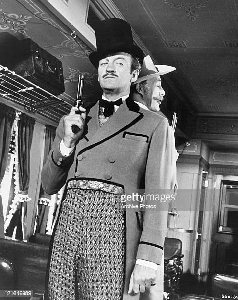 Robert Newton with a gun in his hand in a scene from the film 'Around The world In Eighty Days' 1956