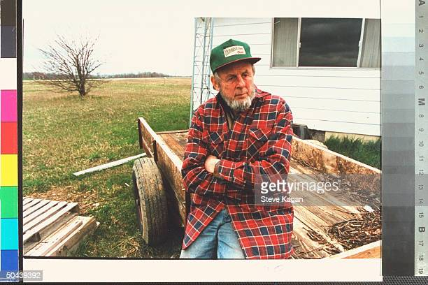 Robert Nichols father of suspected OK City terrorist bombing accomplices Terry James Nichols leaning against wooden cart outside house