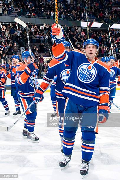 Robert Nilsson of the Edmonton Oilers and his teammates salute the crowd after finally stopping their 13game losing streak the came came against the...