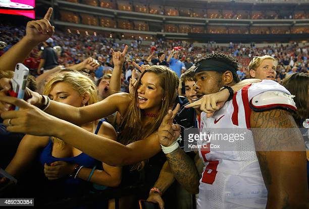 Robert Nkemdiche of the Mississippi Rebels celebrates their 4337 win over the Alabama Crimson Tide at BryantDenny Stadium on September 19 2015 in...