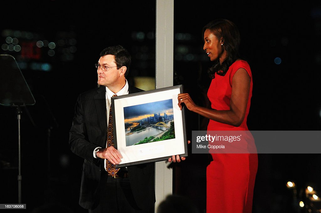 Robert Nutting (L) and Lisa Leslie onstage at the 2013 Natural Resources Defense Council Game Changer Awards at the Mandarin Oriental Hotel on March 14, 2013 in New York City.