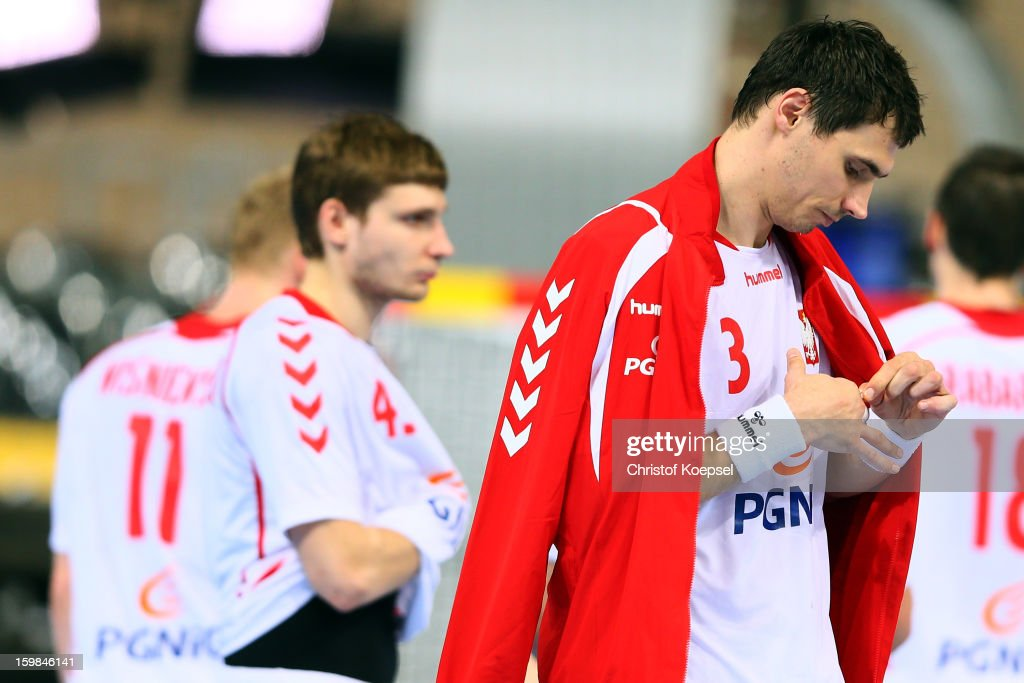 Robert Orzechowski and Krzystof Lijewski of Poland look dejected after the round of sixteen match between Hungary and Poland at Palau Sant Jordi on January 21, 2013 in Barcelona, Spain. The match between Hungary and Poland ended 27-19.