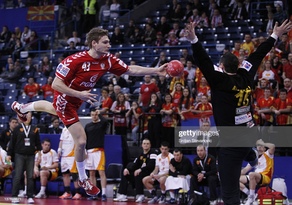 Robert Orzechowski (L) of Poland scores past goalkeeper Borko Ristovski of Macedonia, during the Men's European Handball Championship 2012 second round group one, match between Poland and Macedonia, at Arena Hall on January 23, 2012 in Belgrade, Serbia.