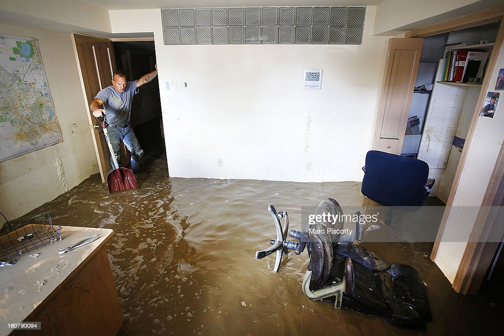 Robert Pandolfi of Longmont, Colorado pauses for a moment while using a shovel to direct water in the basement of his boss' home as residents clean up in the wake of a week of heavy flooding on September 16, 2013 in Longmont, Colorado. More than 600 people are unaccounted for and thousands were forced to evacuate after historic flooding devastated communities in Colorado.