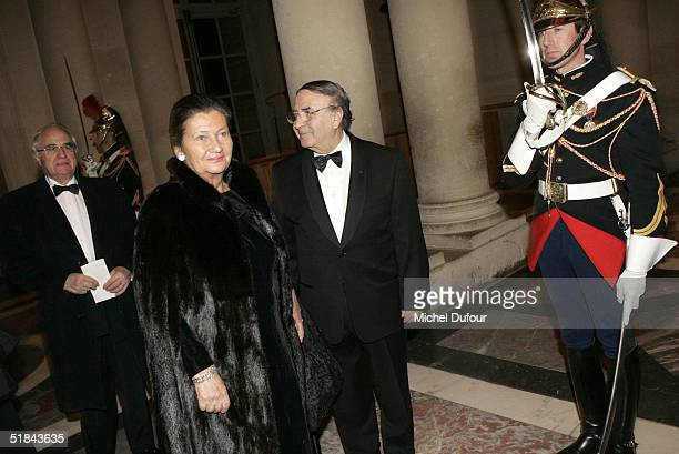 Robert Pariente with Simone Weil and her husband attend the 'Pasteur Weizman 30th Anniversary Party' at the castle of Versailles December 9 2004 in...