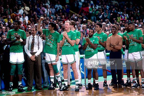 Robert Parish Head Coach Chris Ford Kevin McHale Larry Bird John Bagley Rick Fox Dee Brown Reggie Lewis and the rest of the 1992 Boston Celtics cheer...