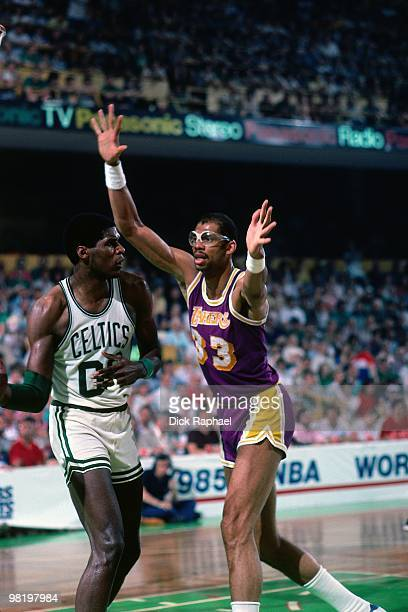Robert Parish of the Boston Celtics passes against Kareem AbdulJabbar of the Los Angeles Lakers during the 1985 NBA Finals at the Boston Garden in...