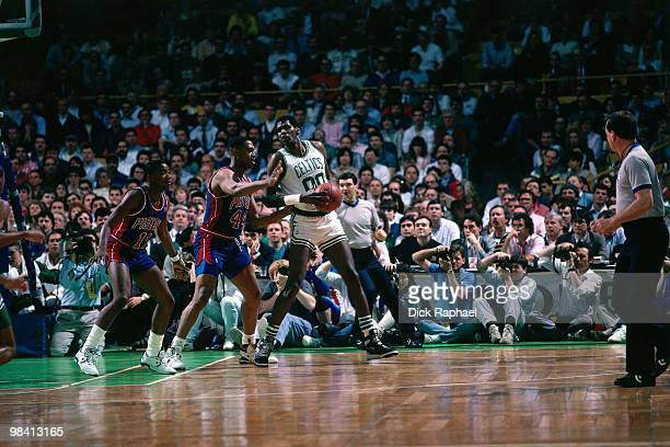 Robert Parish of the Boston Celtics posts up against Rick Mahorn of the Detroit Pistons during a game played in 1989 at the Boston Garden in Boston...