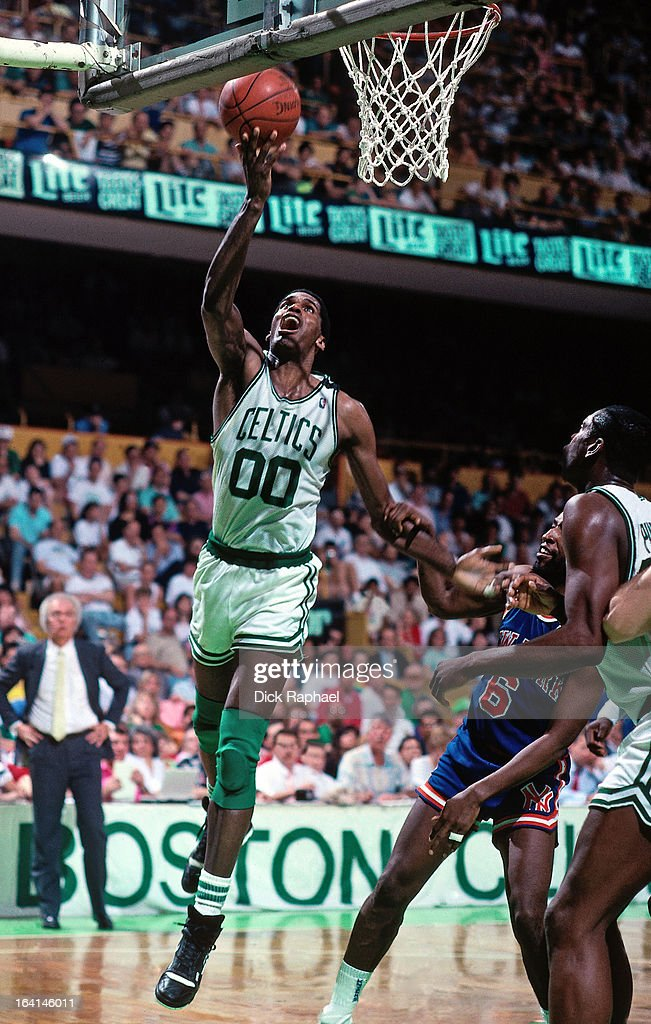 Robert Parish of the Boston Celtics shoots against the New York Knicks during a game played in 1990 at the Boston Garden in Boston Massachusetts NOTE...