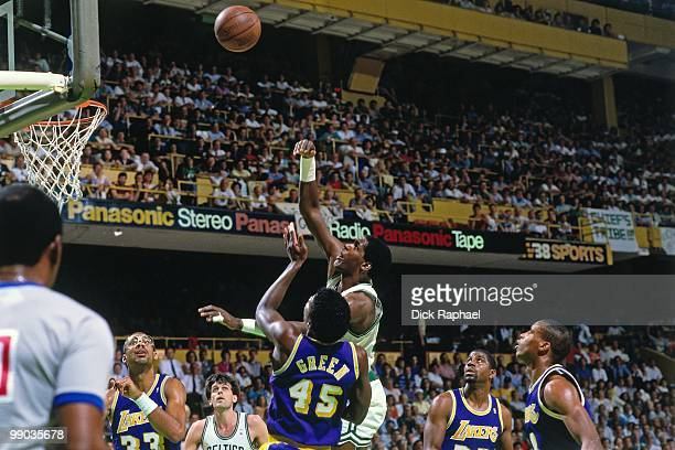 Robert Parish of the Boston Celtics shoots over AC Green of the Los Angeles Lakers during the 1987 NBA Finals at the Boston Garden in Boston...