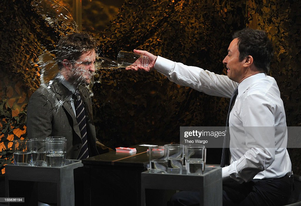 Robert Pattinson and Jimmy Fallon play 'Water War' during a taping of 'Late Night With Jimmy Fallon' at Rockefeller Center on November 8, 2012 in New York City.
