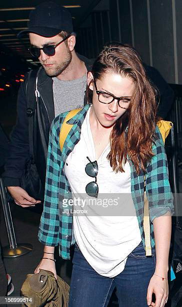 Robert Pattinson and Kristen Stewart are seen at LAX Airport on November 26 2012 in Los Angeles California
