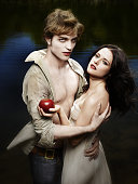 Robert Pattinson and Kristen Stewart pose at a portrait session as their characters from Twilight Cover Image