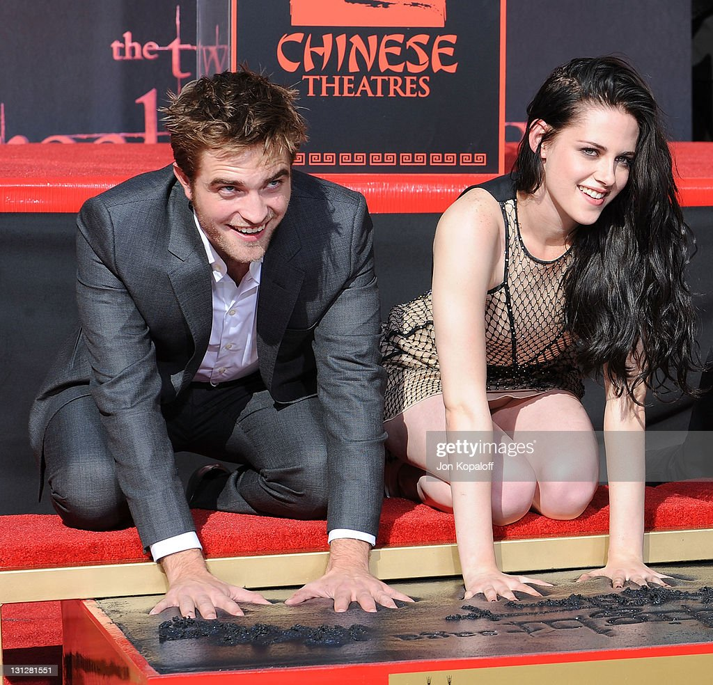 <a gi-track='captionPersonalityLinkClicked' href=/galleries/search?phrase=Robert+Pattinson&family=editorial&specificpeople=734445 ng-click='$event.stopPropagation()'>Robert Pattinson</a> and <a gi-track='captionPersonalityLinkClicked' href=/galleries/search?phrase=Kristen+Stewart&family=editorial&specificpeople=2166264 ng-click='$event.stopPropagation()'>Kristen Stewart</a> pose at 'The Twilight Trio' Hand/Foorprint Ceremony at Grauman's Chinese Theatre on November 3, 2011 in Hollywood, California.