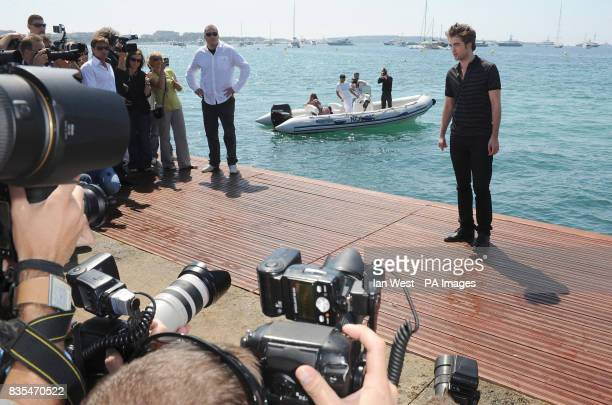Robert Pattinson attends a photocall for new film New Moon on the Majestic Pier in Cannes France