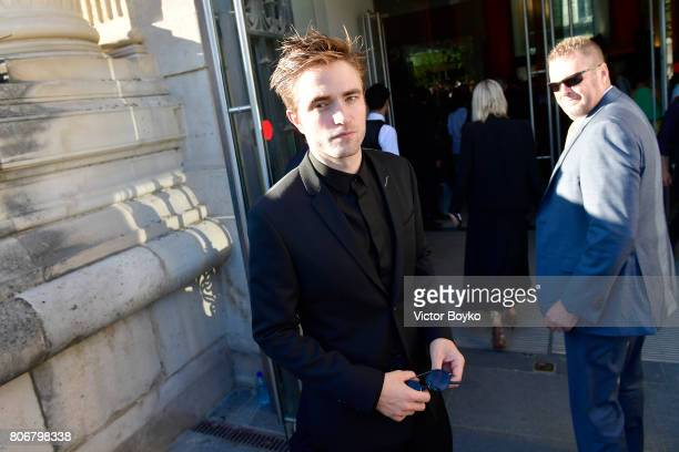Robert Pattinson attends 'Christian Dior couturier du reve' Exhibition Launch celebrating 70 years of creation at Loulou Club on July 3 2017 in Paris...