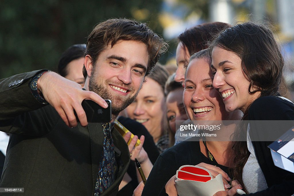 <a gi-track='captionPersonalityLinkClicked' href=/galleries/search?phrase=Robert+Pattinson&family=editorial&specificpeople=734445 ng-click='$event.stopPropagation()'>Robert Pattinson</a> greets fans during a 'Breaking Dawn - Part 2' fan event on October 22, 2012 in Sydney, Australia.